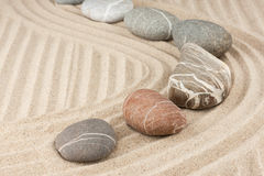 Striped stones on the sand Stock Image