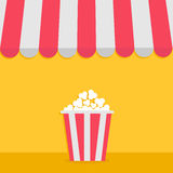 Striped store awning for shop, marketplace, cafe, restaurant. Red white canopy roof. Popcorn big box. Cinema icon. Stock Photo