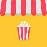 Striped store awning for shop, marketplace, cafe, restaurant. Red white canopy roof. Popcorn box. Cinema icon. Flat design. Yellow. Background. . Vector Royalty Free Stock Image