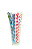 Striped straws for cocktails in glass on white background. Royalty Free Stock Images