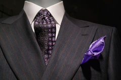 Striped Suit and Purple Handkerchief (Horizonta. Close up of a dark gray striped jacked with white shirt, patterned black & purple tie and purple handkerchief royalty free stock photo