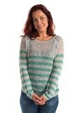 Striped sweater. Pretty redheaded woman in a striped sweater royalty free stock photo