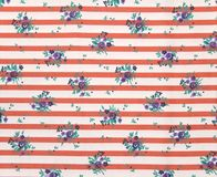 Striped Table Cloth. Table cloth with stripes and flower pattern in red, white and purple Stock Photo