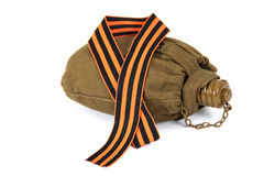 The striped tape lying on the soldier's flask Stock Photography
