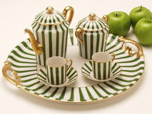 Striped green and withe coffe pot with cups for coffee Royalty Free Stock Image