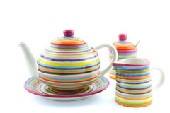 Striped teapot, milk jug and sugar bowl Stock Photos