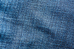 Striped textured blue jeans fabric background Royalty Free Stock Photo