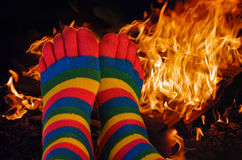 Striped toe socks by fire Stock Photo