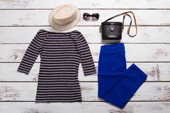 Striped top and blue pants. Royalty Free Stock Photo
