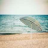 Striped Umbrella On Sandy Beach Royalty Free Stock Image