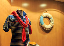 Striped vest and life-buoy Royalty Free Stock Photography
