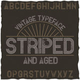 Striped vintage label typeface. Stock Image