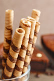 Striped wafer rolls, delicious chocolate snack. Party dessert royalty free stock image