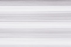 Striped wavy white paper texture, abstract background. Royalty Free Stock Photography