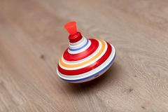 Striped whirligig. The striped whirligig is whirling on a parquet Stock Photos