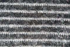 Striped white and gray weave wool yarn closeup Royalty Free Stock Photo