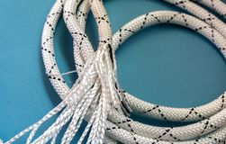 Striped White rope on a blue background stock image