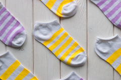 Striped white socks on a white wooden. Background Stock Image