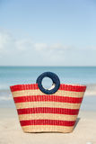 Striped wicker beach bag Stock Photo
