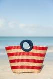 Striped wicker beach bag Stock Photo
