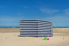 Striped windbreak at the beach Stock Images