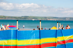 Striped windbreaker on beach in multicolors stripes Royalty Free Stock Image