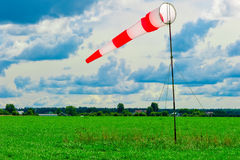 Striped windsock in  green field Stock Images