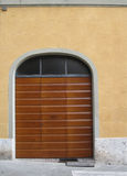 Striped wooden garage door on urban street in Siena, Italy Royalty Free Stock Images