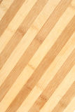 Striped wooden plate Royalty Free Stock Images