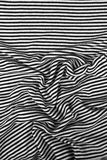 Striped wrinkled black and white zebra fabric cloth background Stock Image