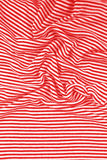 Striped wrinkled red and white zebra fabric cloth background Royalty Free Stock Photography