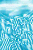 Striped wrinkled turquoise and white zebra fabric Stock Photography