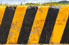 Concrete block on a roadside at summer day royalty free stock photography