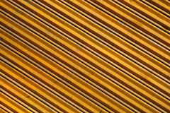 Striped yellow metal. Yellow striped steel wall (as a background Royalty Free Stock Photos