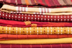 Striped yellow and red colorful fabric. Pile royalty free stock photography