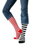 Stripes. Mismatched striped socks isolated against a white backdrop stock image