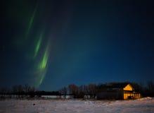 Stripes of aurora borealis in night sky Royalty Free Stock Image