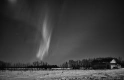 Stripes of aurora borealis in night sky Stock Photos