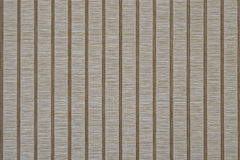 Stripes background vertical. Natural fibers bonded by weaving transverse threads to form a flat fabric with contrasting cross vertical lines and rhythmic Royalty Free Stock Photo