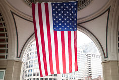 Stripes in Boston. The huge flag under the ark of a hotel building in Boston downtown (Massachusetts Stock Photography