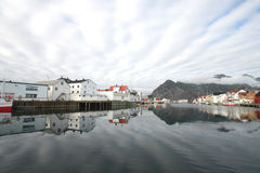 Stripes of clouds above Henningsvaer Royalty Free Stock Images