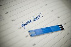 Stripes for glucose test, reminding note in personal organiser. Royalty Free Stock Photography