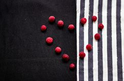 Strips and raspberry on the texture of the fabric stock photos