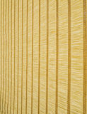 Stripes natural background vertical. Natural fibers bonded by weaving transverse threads to form a flat fabric with contrasting cross vertical lines and rhythmic Stock Photography