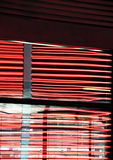 Stripes of red neon lights, with reflections Royalty Free Stock Images