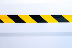 Stripes safety. On the wall of a warehouse Stock Photography