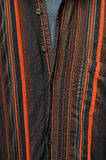 Stripey shirt. Closeup of partially unbutton red stripey shirt Royalty Free Stock Images
