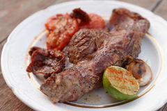 Striploin steak grilled with vegetables Stock Photo