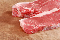 Striploin steak on wood Royalty Free Stock Photography