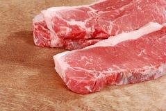 Striploin steak on wood royalty free stock photography